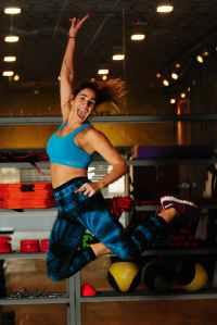 woman in blue sports bra jumping photo